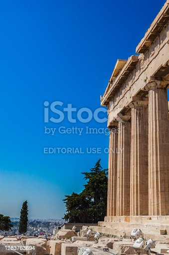 Athens, Greece - July 02, 2018: Partial view of the Parthenon at Acropolis and a part of Athens. You can see tourists on the site.