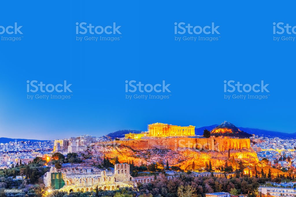 Parthenon and Herodium construction in Acropolis Hill in Athens, Greece. Twilight scenery. stock photo