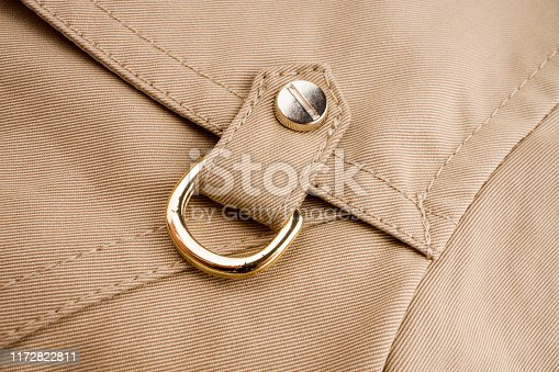 Partial close-up view of lady trench coat