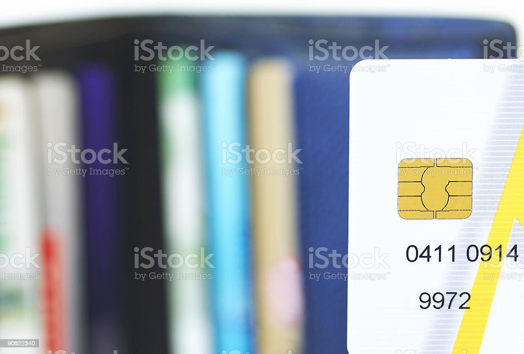 partial credit card in front of wallet royalty-free stock photo