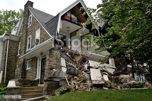 Philadelphia, PA, USA - May 22, 2018; Emergency crews respond to a partial home collapse in the West Mount Airy neighborhood in Philadelphia, PA, on May 22, 2018.