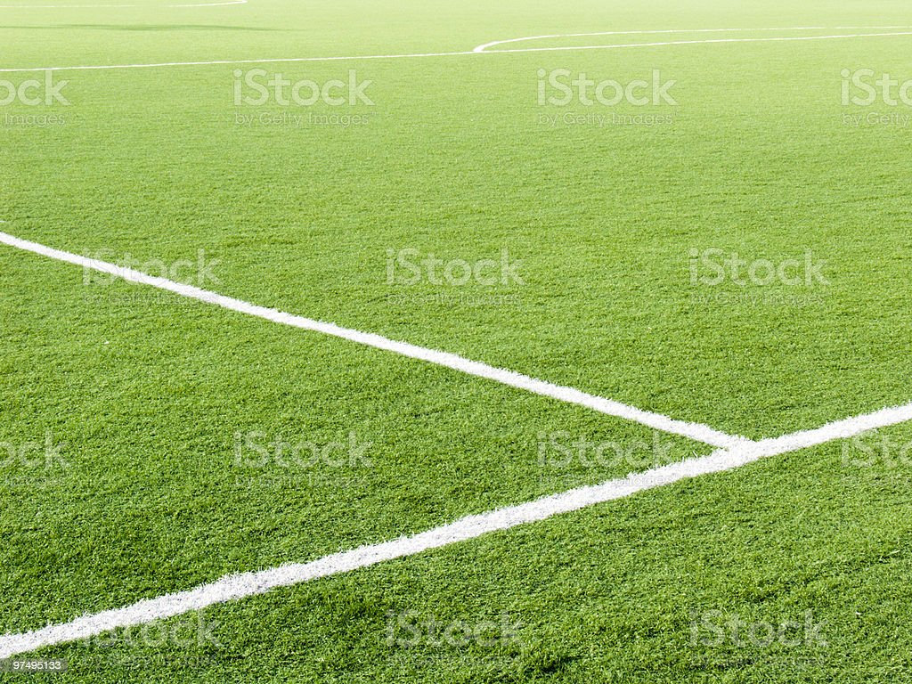 Partial landscape of the white lines on a green soccer field royalty-free stock photo