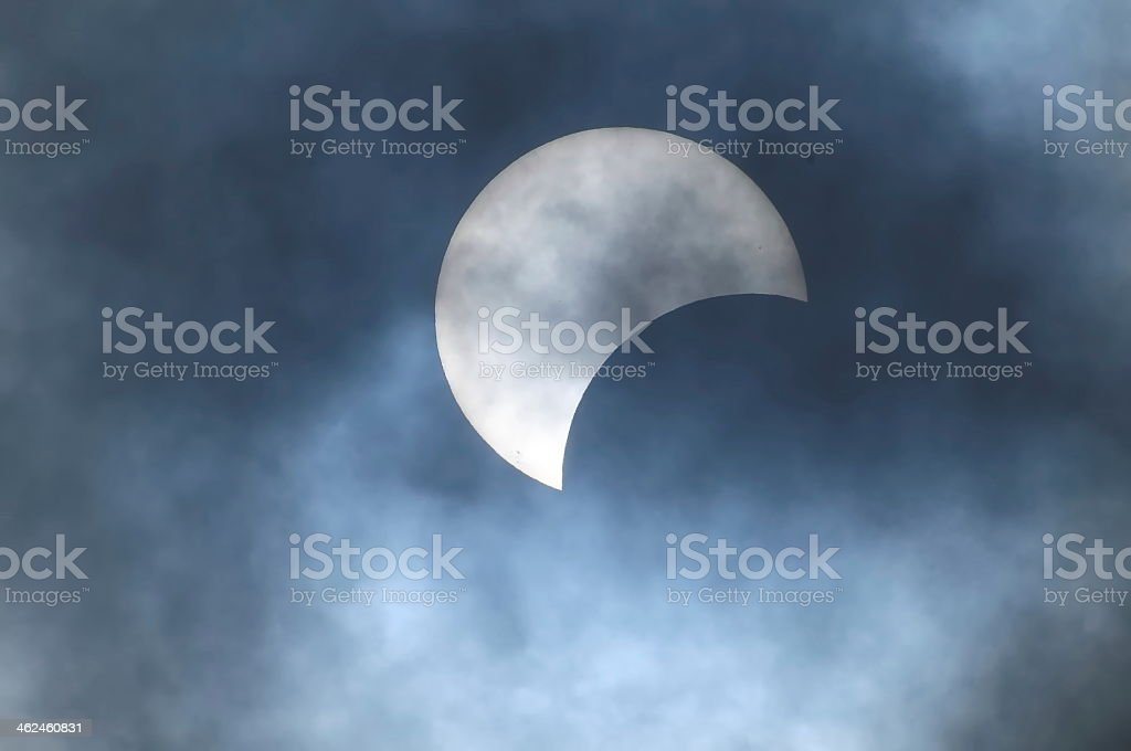 Partial moon eclipse in a misty night stock photo