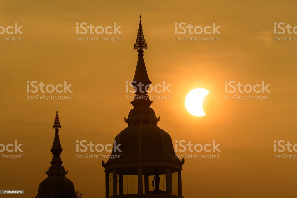Partial solar eclipse in the morning stock photo
