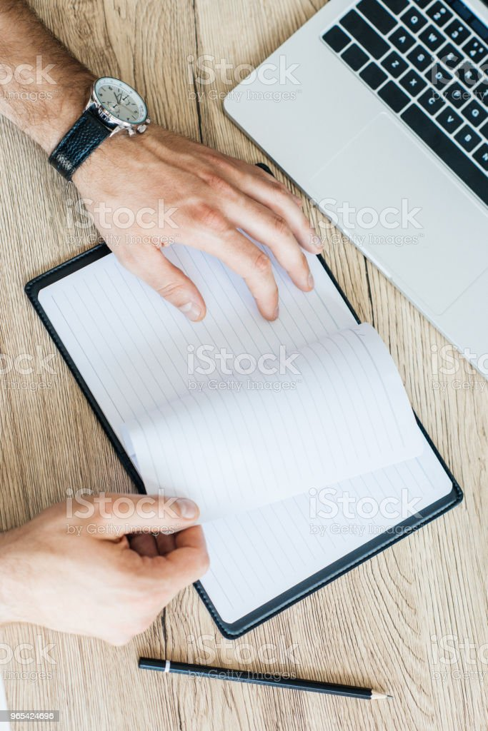 partial top view of person holding blank notebook at workplace royalty-free stock photo