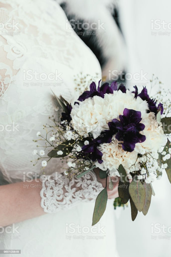 partial view of bride in white dress with beautiful bridal bouquet in hands zbiór zdjęć royalty-free