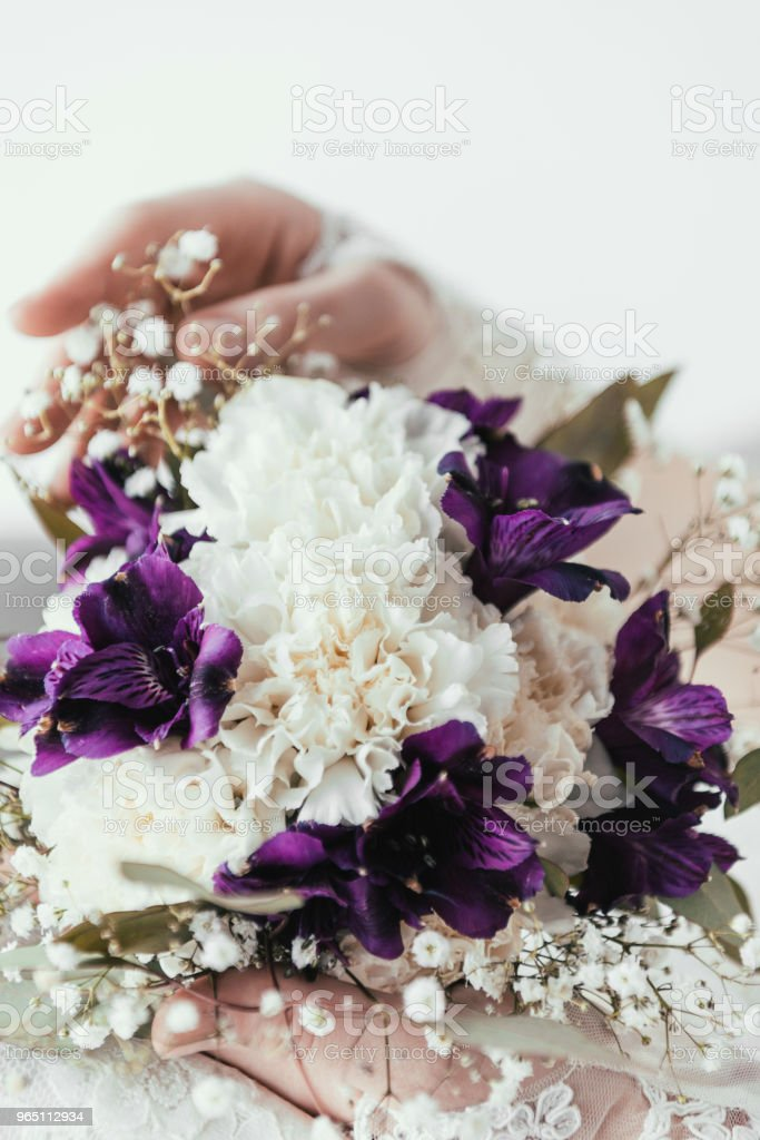 partial view of bride in white dress with beautiful bridal bouquet in hands royalty-free stock photo
