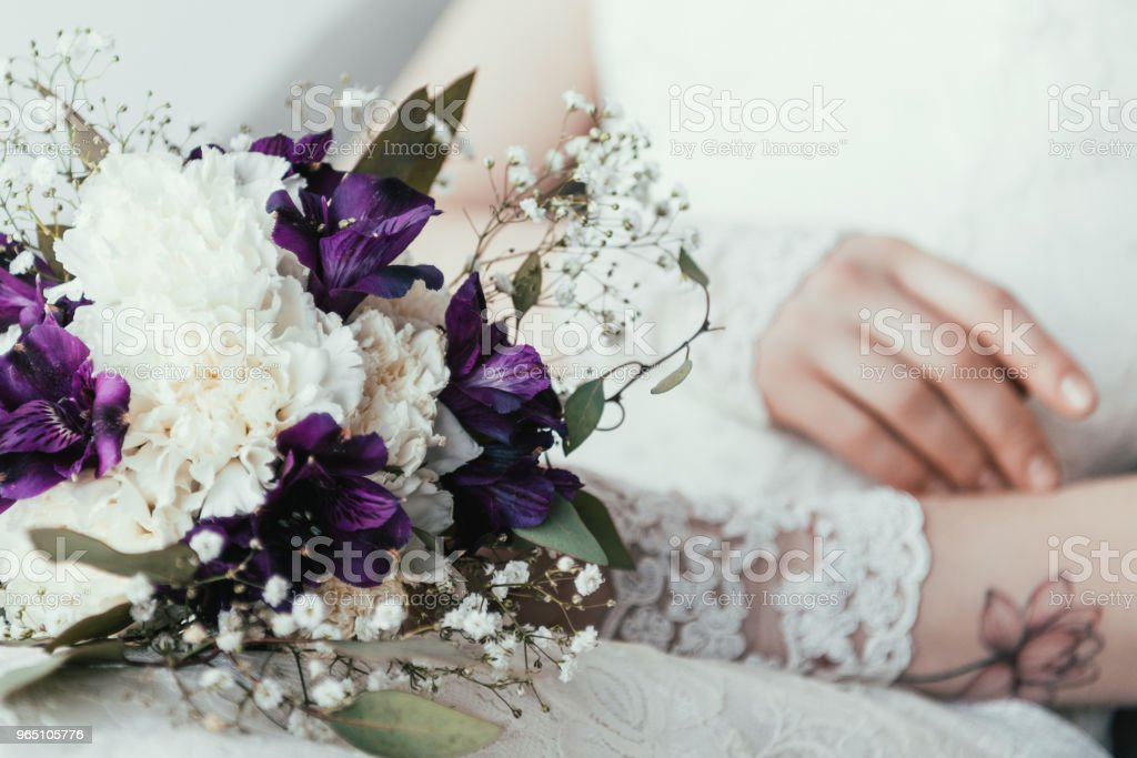 partial view of bride in white dress with beautiful bridal bouquet royalty-free stock photo