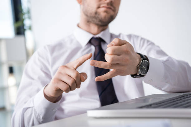 partial view of businessman counting on fingers at workplace, business concept stock photo