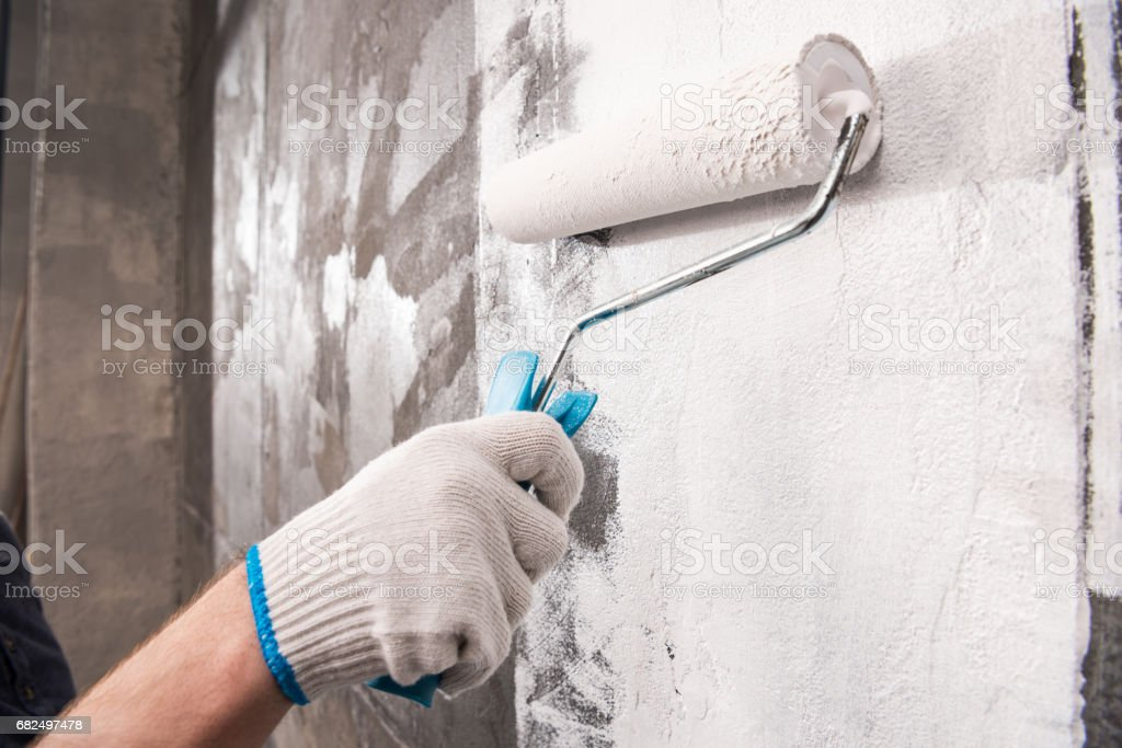 partial view of man painting wall, renovation home concept royalty-free stock photo