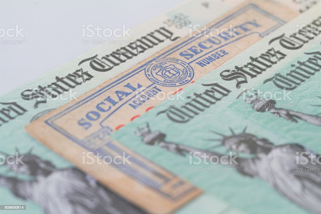 Partial view of Social Security card and US Treasury checks stock photo