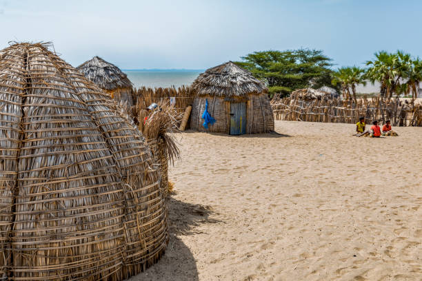Partial view of traditional round bomas of semi-nomadic Turkana people, on shores of Lake Turkana, Kenya. stock photo