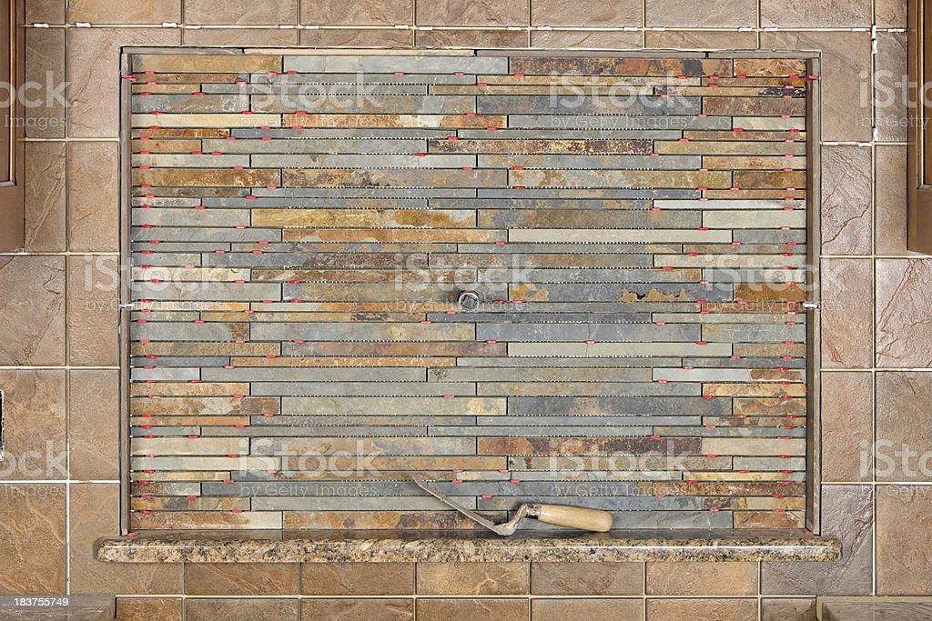 Partially Complete Stacked Stone Kitchen Backsplash Installation stock photo