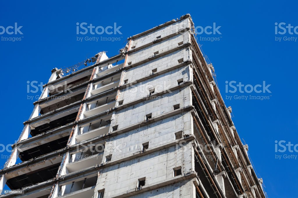 Partially demolished building against clear blue sky royalty-free stock photo