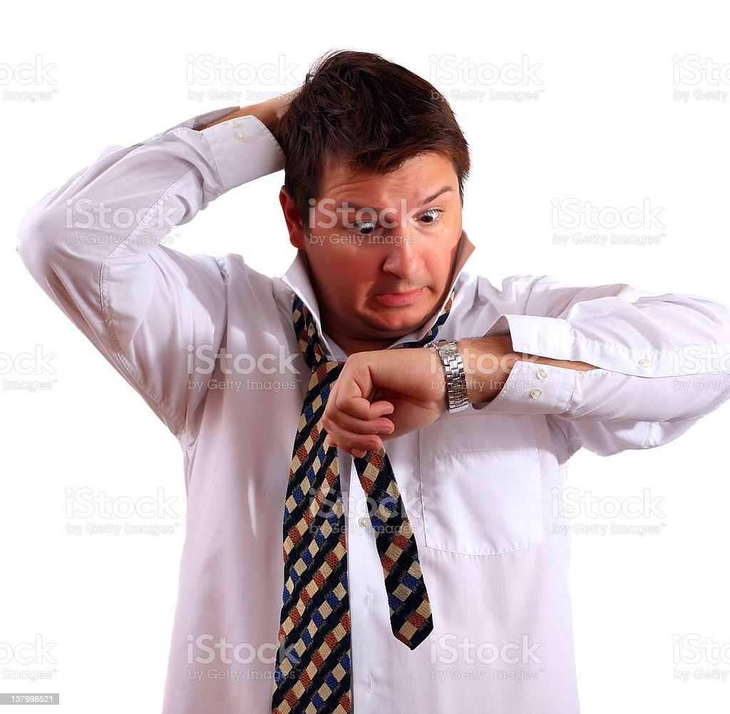 Partially dressed worker staring anxiously at watch royalty-free stock photo