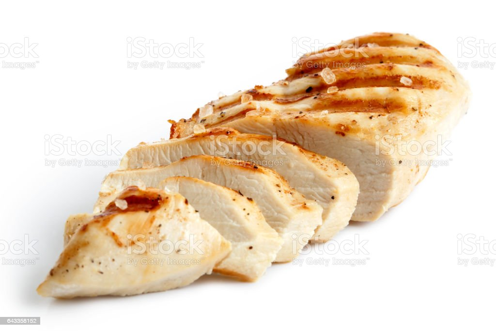 Partially sliced grilled chicken breast with black pepper. stock photo