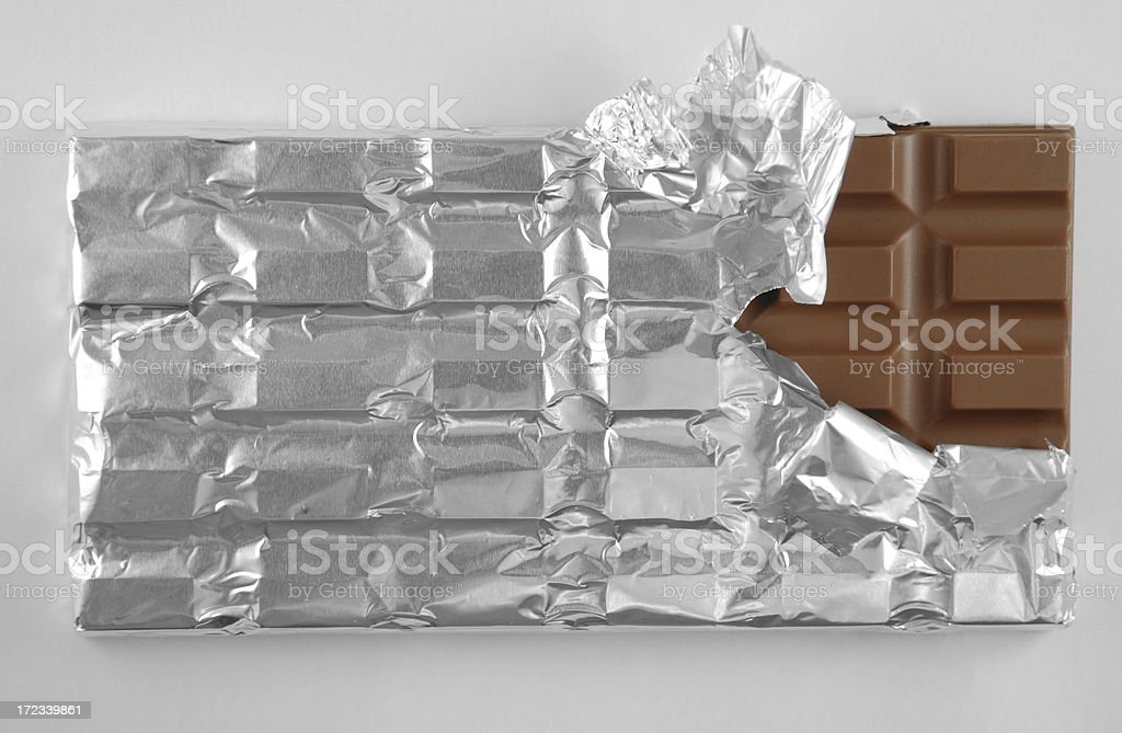 Partially Unwrapped Bar of Chocolate stock photo