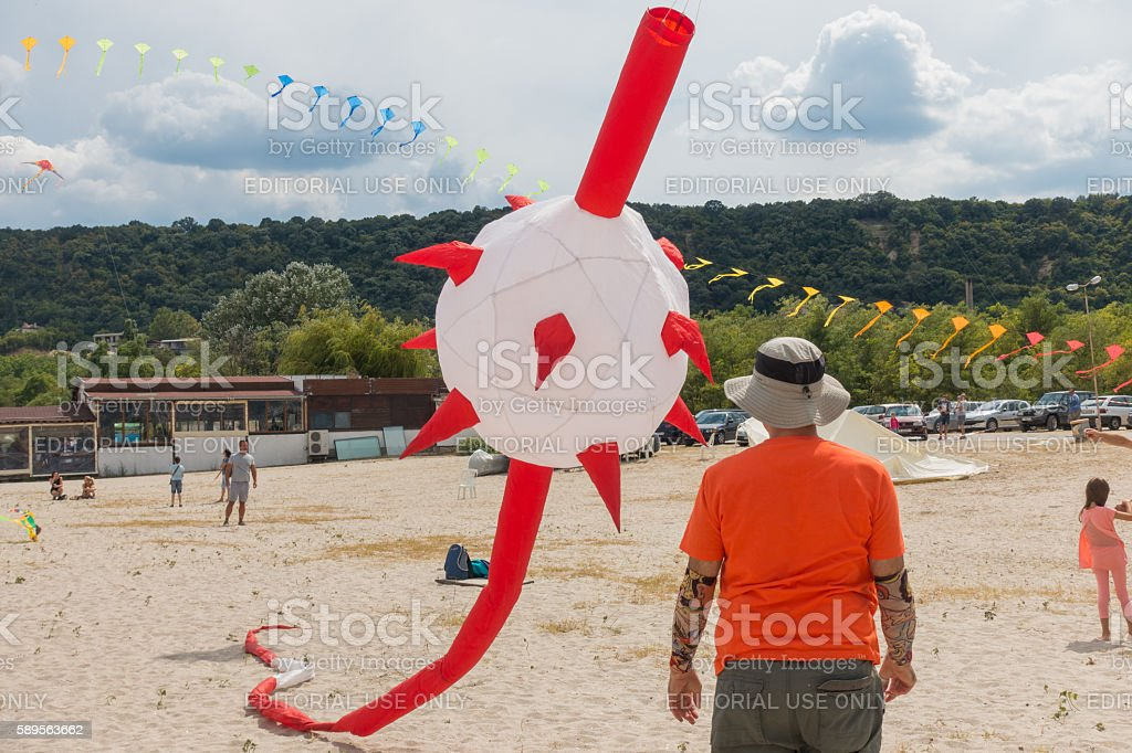Participant flyes a huge 'morningstar' kite. stock photo