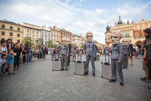 Participants at the annually International Festival of Street Theatres Krakow, Poland - July 12, 2015: Participants at the annually (Jul 9-12) 28th International Festival of Street Theatres - Teatr KTO (PL) Peregrinus in Main Square and at random points around the city. annually stock pictures, royalty-free photos & images