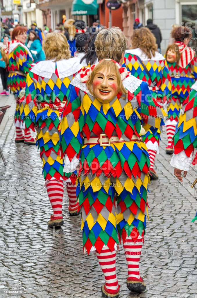 Participants in costumes perform a street procession Carneval Fasnacht January 17, 2016 in the city of Lahr, Germany. Traditionally, the festive and cultural carnival procession through the streets of cities and towns in Germany stock photo