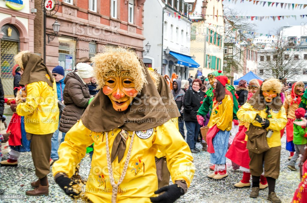 Participants in costumes perform a street procession Carneval Fasnacht January 17, 2016 in the city of Lahr, Germany. They perform Gugge Music and dress up as witches. stock photo