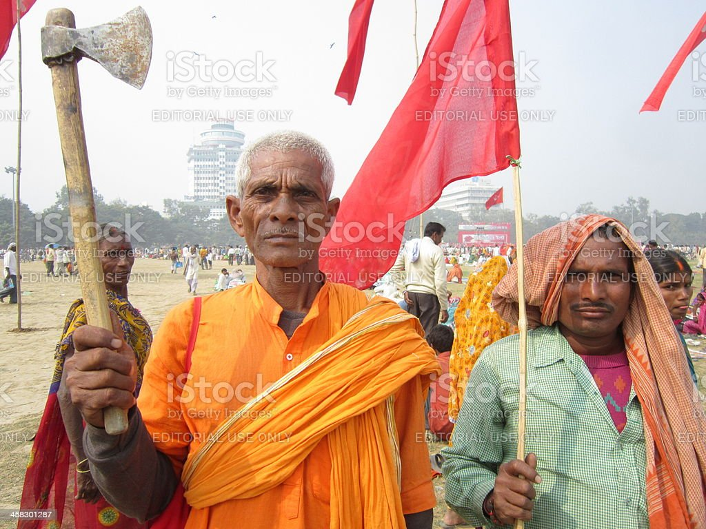 Participants in Parivartan Rally wielding an axe and red flag. royalty-free stock photo