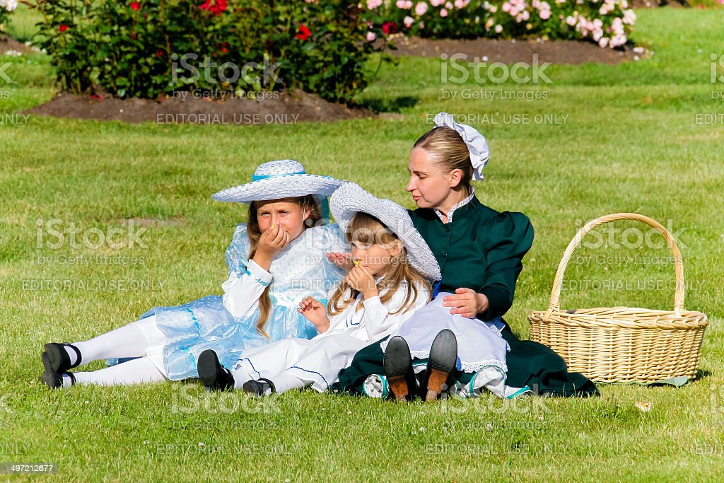 Participants of historical show of early 20th century play picnic stock photo