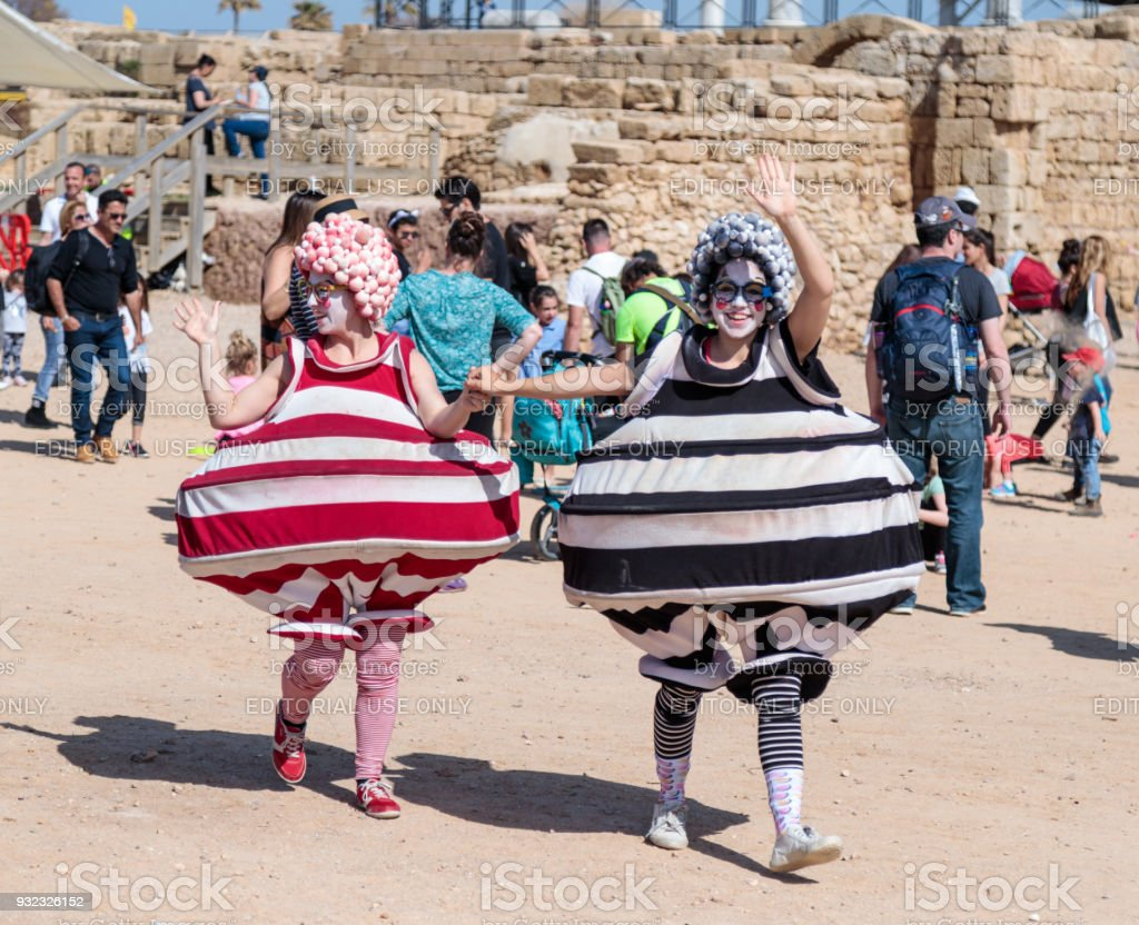 A participants of the Purim festival dressed in fabulous costumes go and greet visitors in Caesarea, Israel stock photo