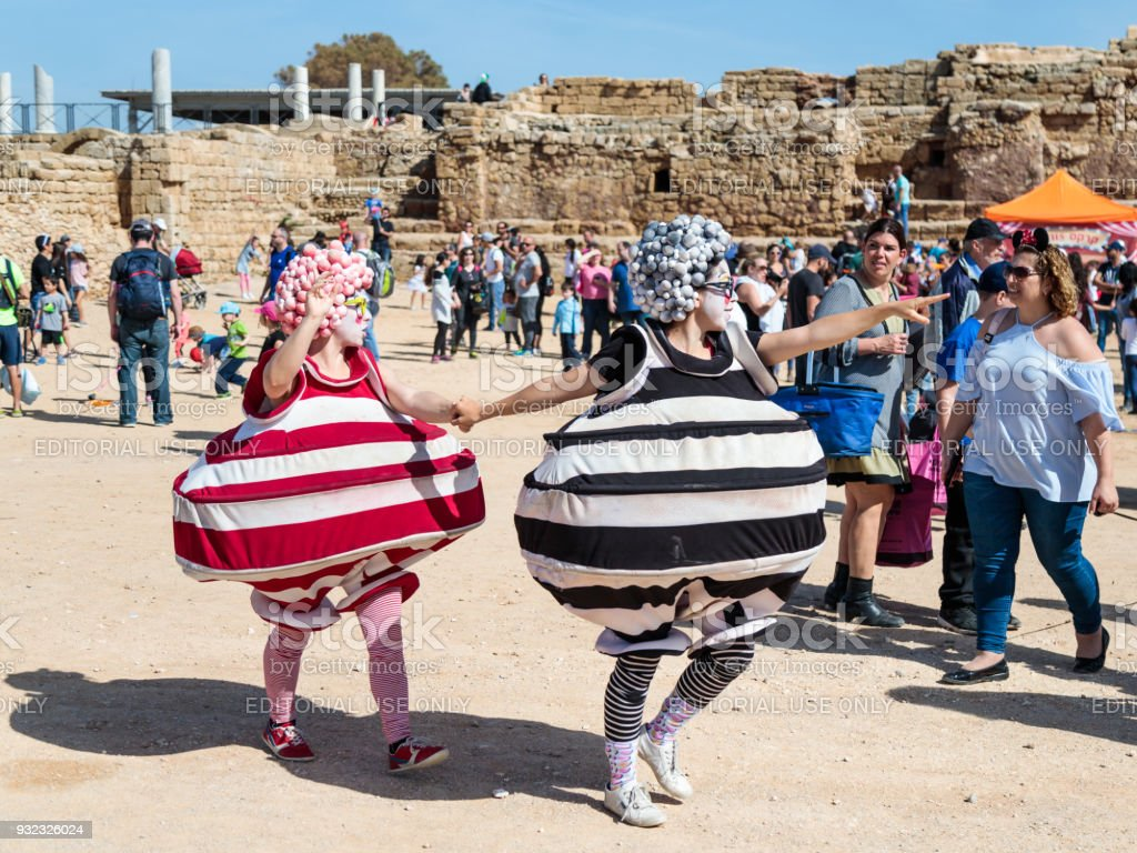 A participants of the Purim festival dressed in fabulous costumes, show performance in Caesarea, Israel stock photo