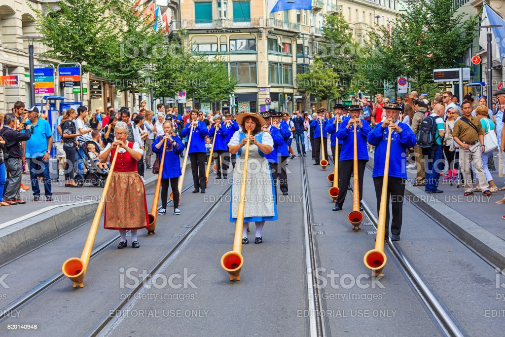 Participants of the Swiss National Day parade in the city of Zurich, Switzerland stock photo