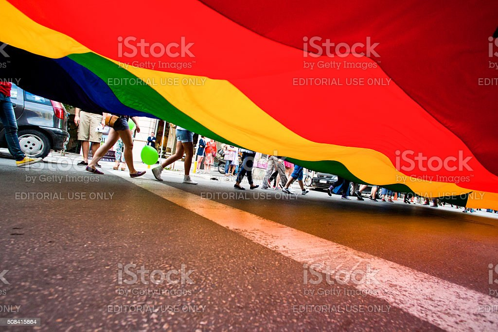 Participants with the rainbow flag stock photo