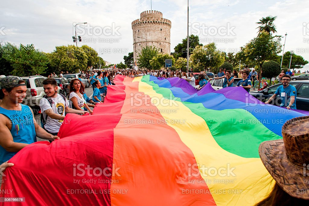 Participants with the rainbow flag, the symbol of the gay stock photo