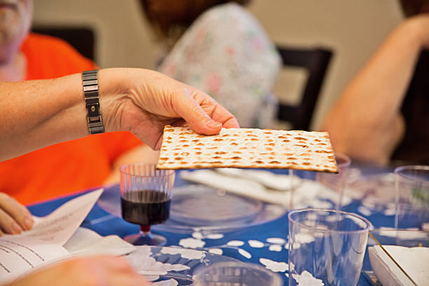participating in a traditional passover seder - jodijacobson stock pictures, royalty-free photos & images