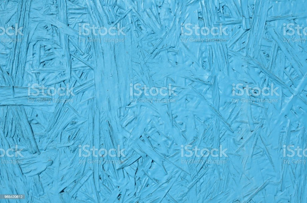 Particle board painted blue zbiór zdjęć royalty-free