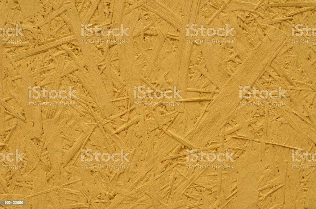 Particle board painted in yellow royalty-free stock photo