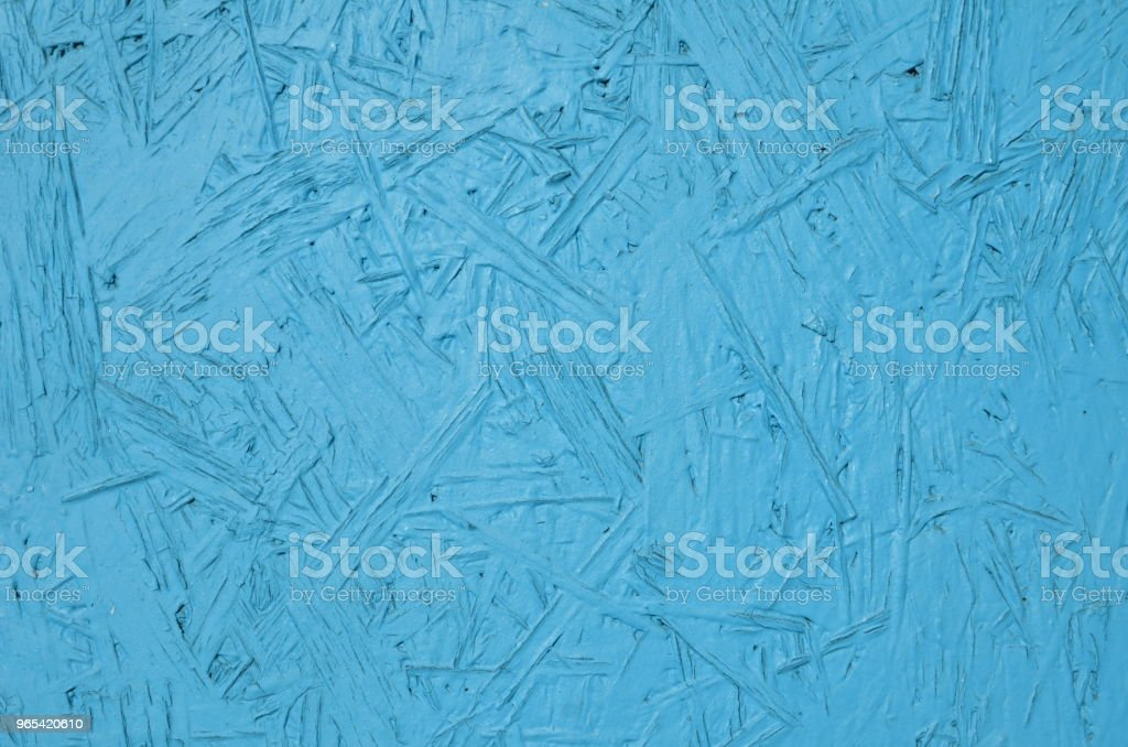 Particle board panel painted in blue royalty-free stock photo