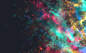 3D render of many flowing colorful particles