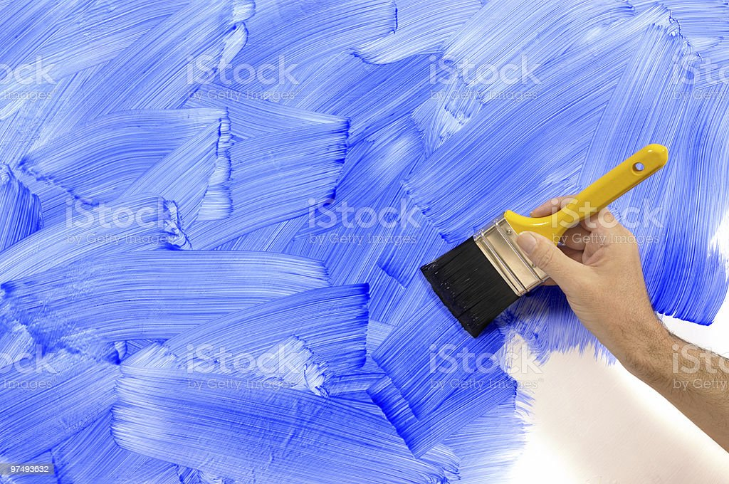 Partly painted blue wall royalty-free stock photo
