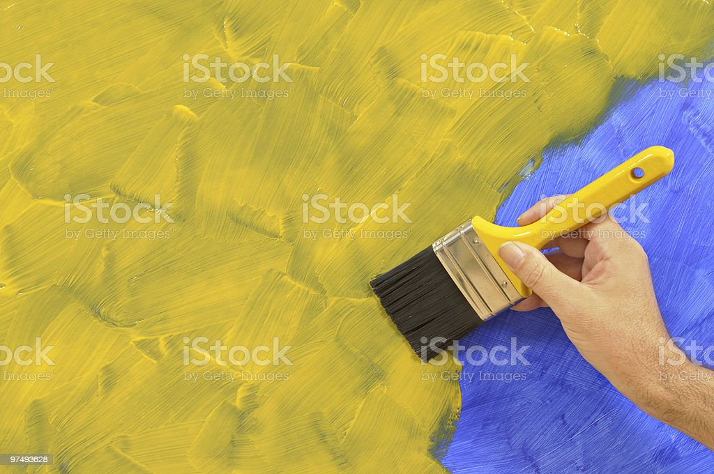 Partly painted yellow and blue wall royalty-free stock photo