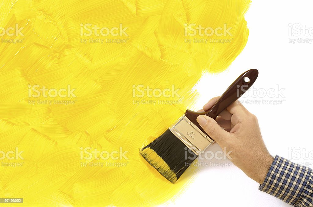 Partly painted yellow wall royalty-free stock photo