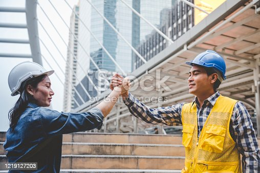 1016771914 istock photo Partner Business Trust Teamwork Partnership. Industry contractor fist bump dealing mission business. Mission team meeting group of People Fist bump Hands together. Business industry trust teamwork 1219127203