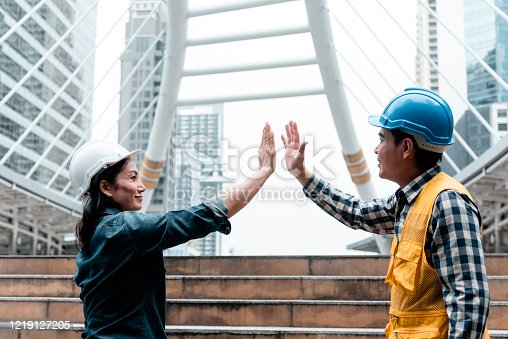 1016771914 istock photo Partner Business Trust Teamwork Partnership. Industry contractor fist bump dealing mission business. Mission team meeting group of People Fist bump Hands together. Business industry trust teamwork 1219127205
