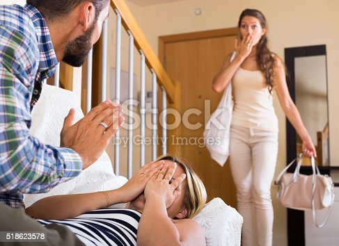 490286900istockphoto Partner discovering adultery 518623578