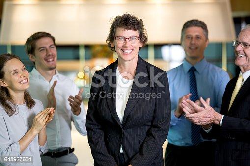 istock Partners Applauding to Happy Senior Business Woman 648927634