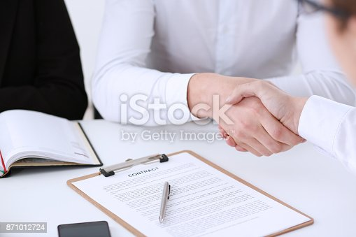 859896852istockphoto Partnership agreement closeup with man 871012724