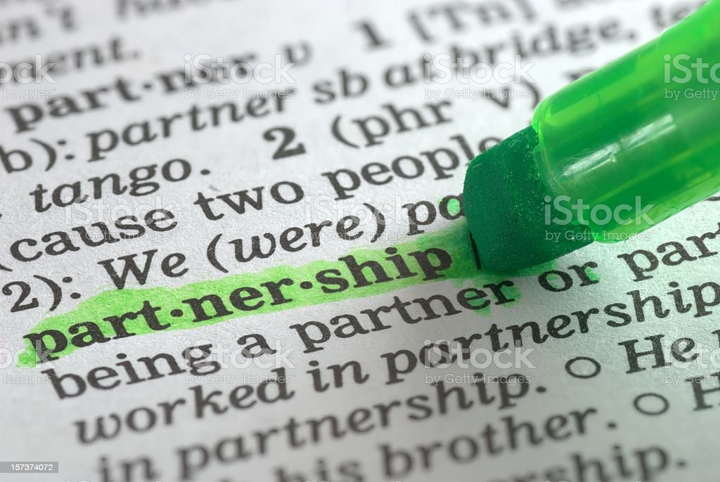 partnership definition highlighted in dictionary royalty-free stock photo