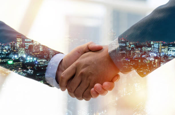 partnership. double exposure image of investor business man handshake with partner for successful meeting deal with during sunrise and cityscape background, investment, partnership, teamwork concept - real estate law stock photos and pictures