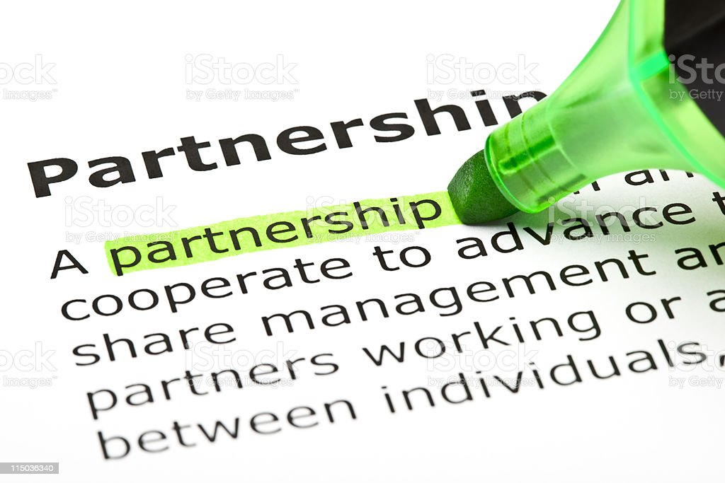 Partnership highlighted in green royalty-free stock photo