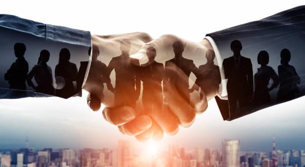 partenariat de concept d'entreprise. groupe d'homme d'affaires. soutien à la clientèle. travail d'équipe. - se saluer photos et images de collection