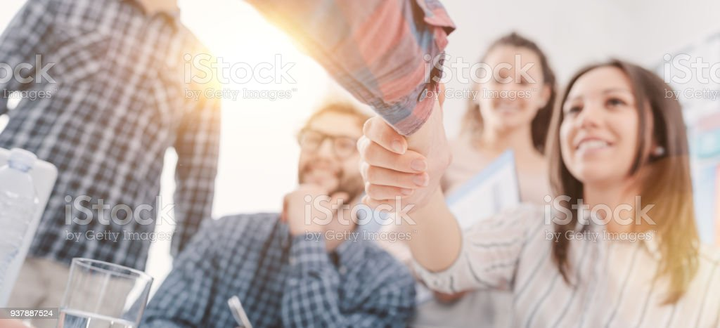 Partnerships and startups: business people shaking hands stock photo
